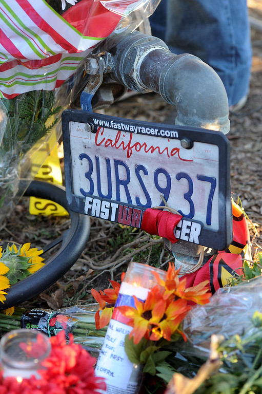 . A license plate at a memorial for Paul Walker and Roger Rodas, Sunday, December 1, 2013, at the scene of their fatal crash site on Hercules Street near Kelly Johnson Parkway in Valencia. (Photo by Michael Owen Baker/L.A. Daily News)