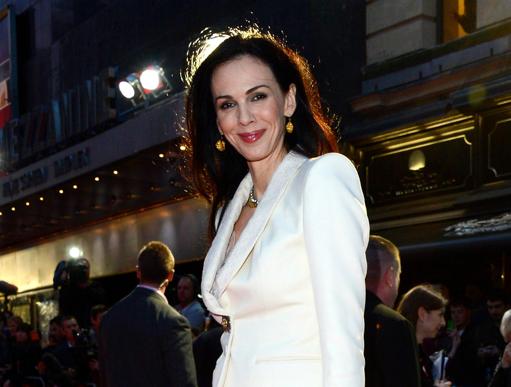 ". This Oct. 18, 2012 file photo shows L\'Wren Scott at the London Film Festival American Express Gala for ""The Rolling Stones - Crossfire Hurricane\"", in London. Scott, a fashion designer, was found dead Monday, March 17, 2014, in Manhattan of a possible suicide. (Photo by Jon Furniss/Invision, File)"