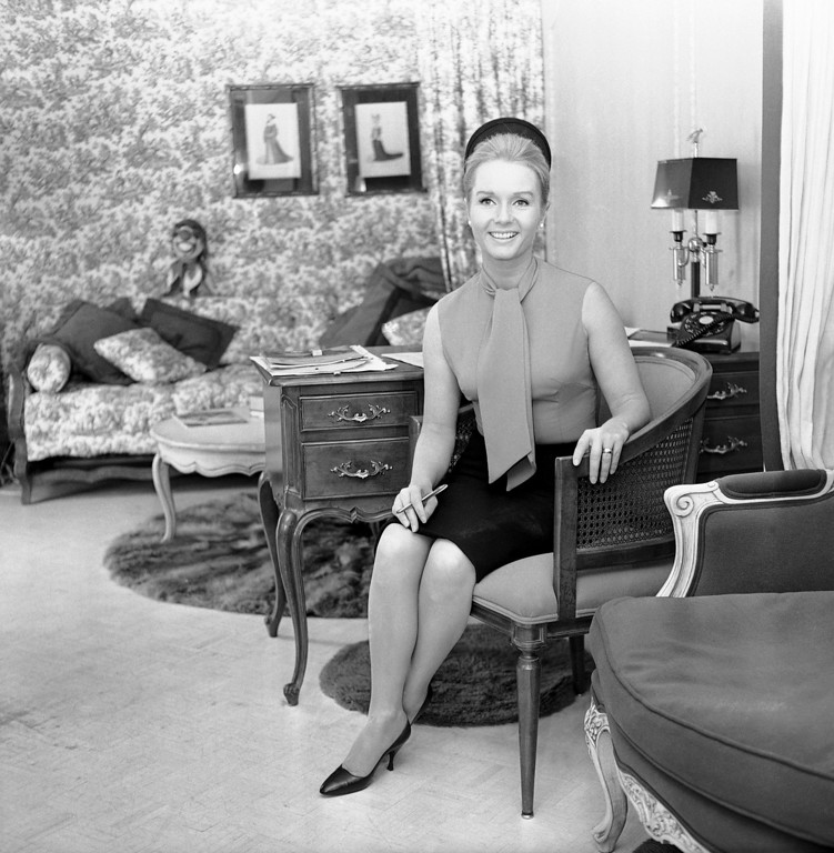 . Debbie Reynolds\' box-like trailer is tastefully furnished with French provincial furniture with matching wallpaper and curtains,and is used as a dressing room, July 11, 1966. It\'s located on the Columbia Pictures lot in Los Angeles. (AP Photo/David F. Smith)
