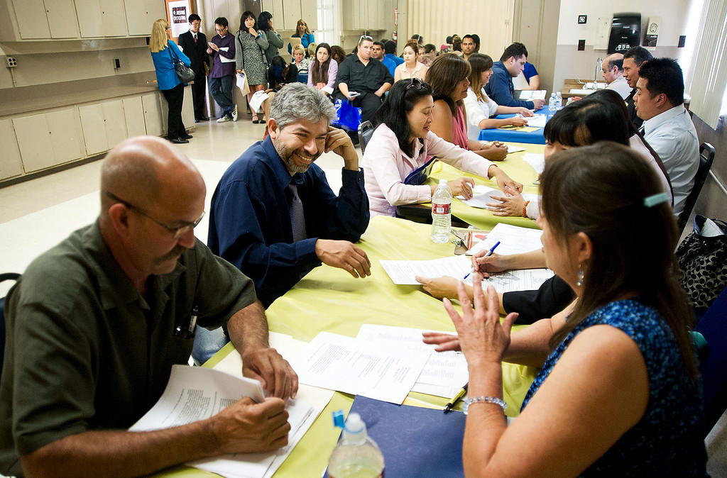 . Job seekers get their resume critique by professionals during the El Monte Job Fair, one of the largest job fairs in the San Gabriel Valley, at the El Monte Community Center on Friday, June 21, 2013. Over the last 12 months California\'s economy added 252,100 jobs, a growth rate of 1.8 percent. (SGVN/Staff photo by Watchara Phomicinda)