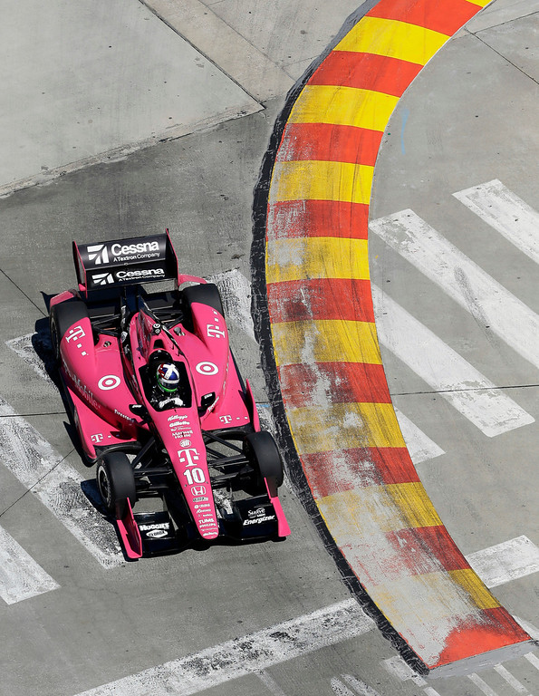 . Dario Franchitti, of Scotland, drives through turn three during the second IndyCar Grand Prix of Houston auto race, Sunday, Oct. 6, 2013, in Houston. Franchitti crashed later in the race and was taken to the hospital. (AP Photo/David J. Phillip)