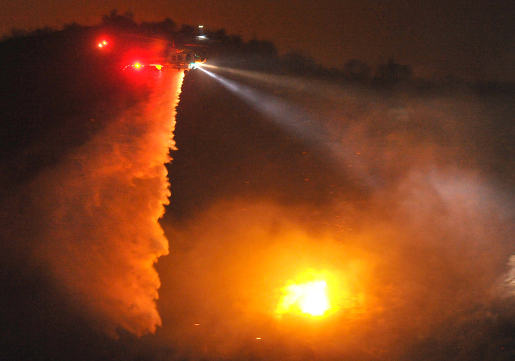 . Los Angeles County Fire Department water dropping helicopters make night water drop to battle the Madre Fire in northwest of Highway 38 in Azusa on Monday September 23, 2013. (San Gabriel Valley Tribune/Staff Photo by Keith Durflinger)