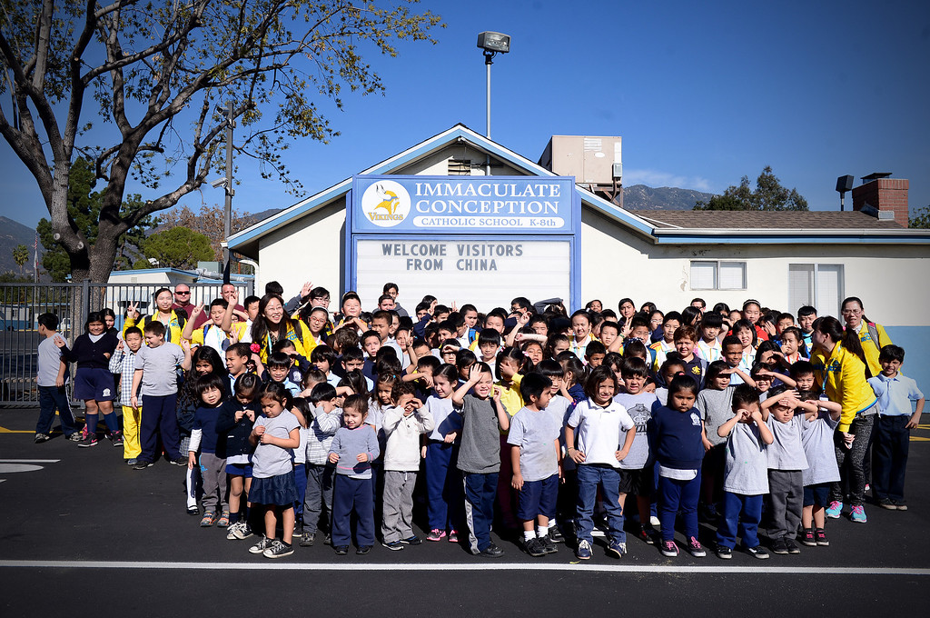 . Students from Harbin Normal University in China pose with Immaculate Conception Catholic School students during their visit to the Monrovia school Wednesday, January 22, 2014. (Photo by Sarah Reingewirtz/Pasadena Star-News)