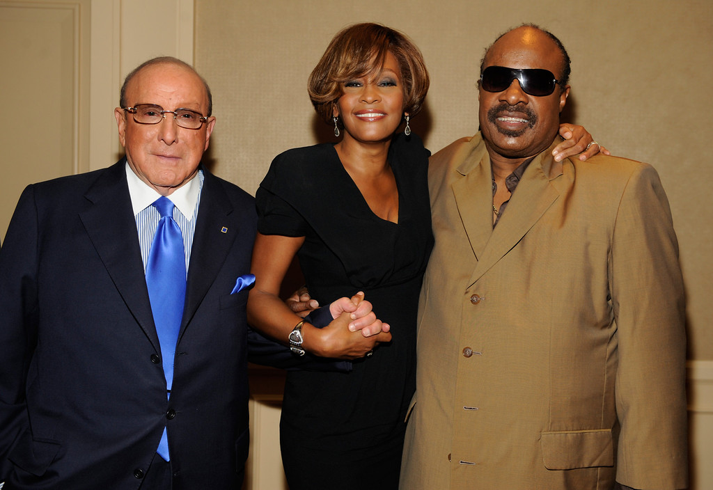 """. (L-R) Chief Creative Officer, Sony Music Worldwide, Clive Davis and singers Whitney Houston and Stevie Wonder during the Whitney Houston \""""I Look To You\"""" CD Listening Party held at the Beverly Hilton Hotel on July 23, 2009 in Beverly Hills, California. (Photo by Frank Micelotta/Sony Music)"""