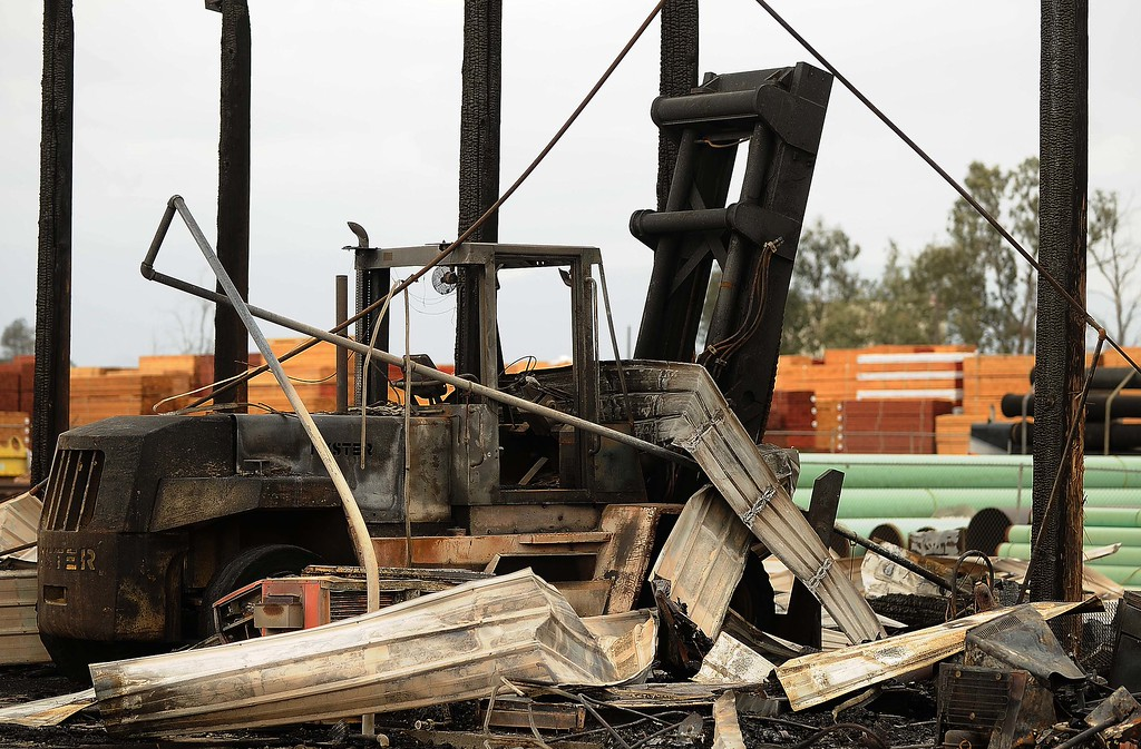 . California Cascade Industries, next door to Ramirez Pallets, also lost a building after the fire jumped a fence. (LaFonzo Carter/Staff Photographer)