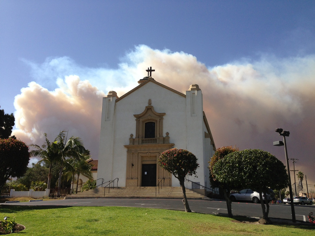 . Smoke from the Springs Fire billows behind St. Mary Magdalen Church in Camarillo, Calif., on May 2, 2013. (Michael Owen Baker/Los Angeles Daily News)
