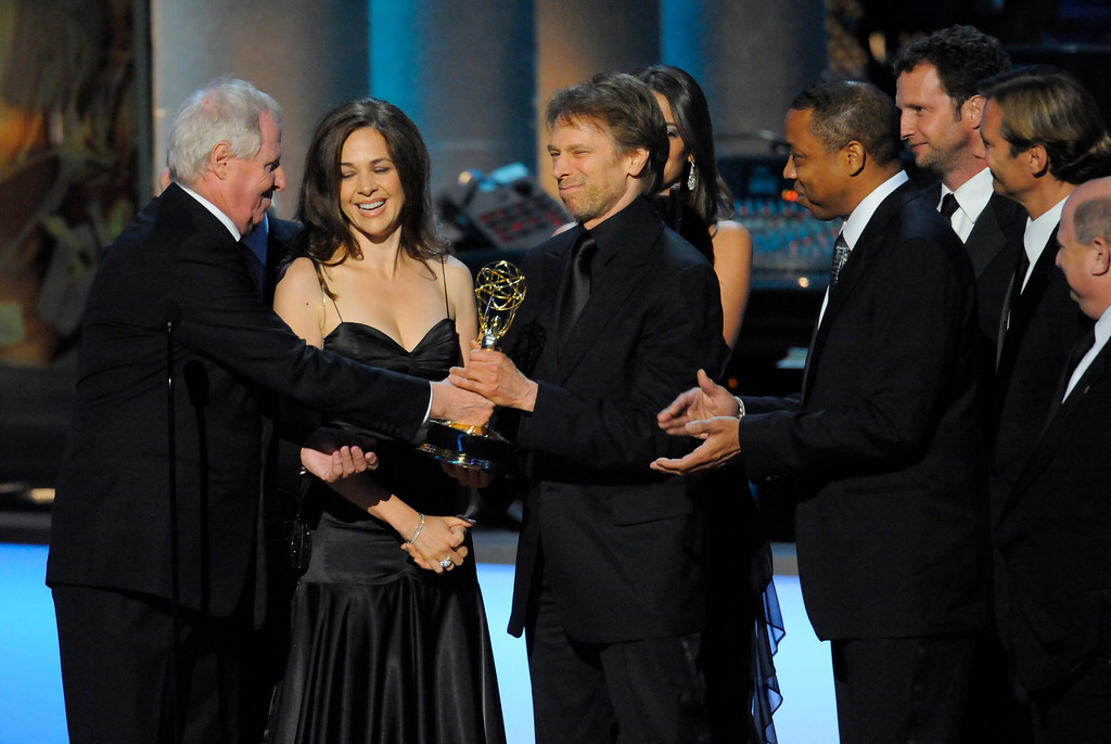 """. Bert Van Munster, left, and Jerry Bruckheimer of \""""The Amazing Race,\"""" accept the award for best reality competition program at the 61st Primetime Emmy Awards on Sunday, Sept. 20, 2009, in Los Angeles. (AP Photos/Mark J. Terrill)"""