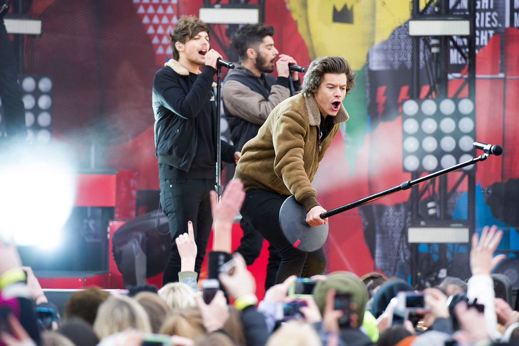 ". One Direction members, from left, Louis Tomlinson, Zayn Malik and Harry Styles perform on ABC\'s ""Good Morning America\"" on Tuesday, Nov. 26, 2013 in New York. (Photo by Charles Sykes/Invision/AP)"