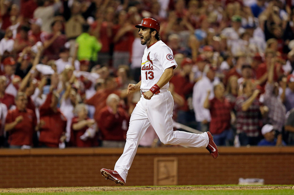 . St. Louis Cardinals\' Matt Carpenter celebrates as he scores on a double by Carlos Beltran during the third inning of Game 1 of the National League baseball championship series against the Los Angeles Dodgers Friday, Oct. 11, 2013, in St. Louis. (AP Photo/Jeff Roberson)