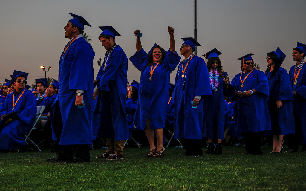 . The line is finally nearing it\'s end during the graduation ceremony, at John H Francis Polytechnic High School, Sun Valley, Calif., June 7, 2013. Photo: Lynn Levitt.