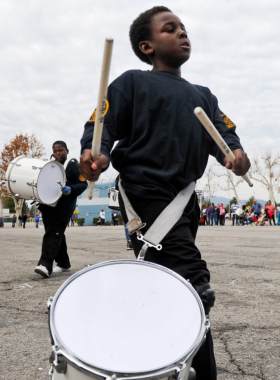 """. A drummer performs during the 44th annual Black History Parade at the National Orange show in San Bernardino on Saturday, Feb. 2, 2013. Hosted by the Southern California Black chamber of Commerce, this year\'s parade theme marked tribute to the 50th anniversary of Dr. Martin Luther King Jr. speech, \""""I Have a Dream.\"""" (Staff file photo/The Sun)"""