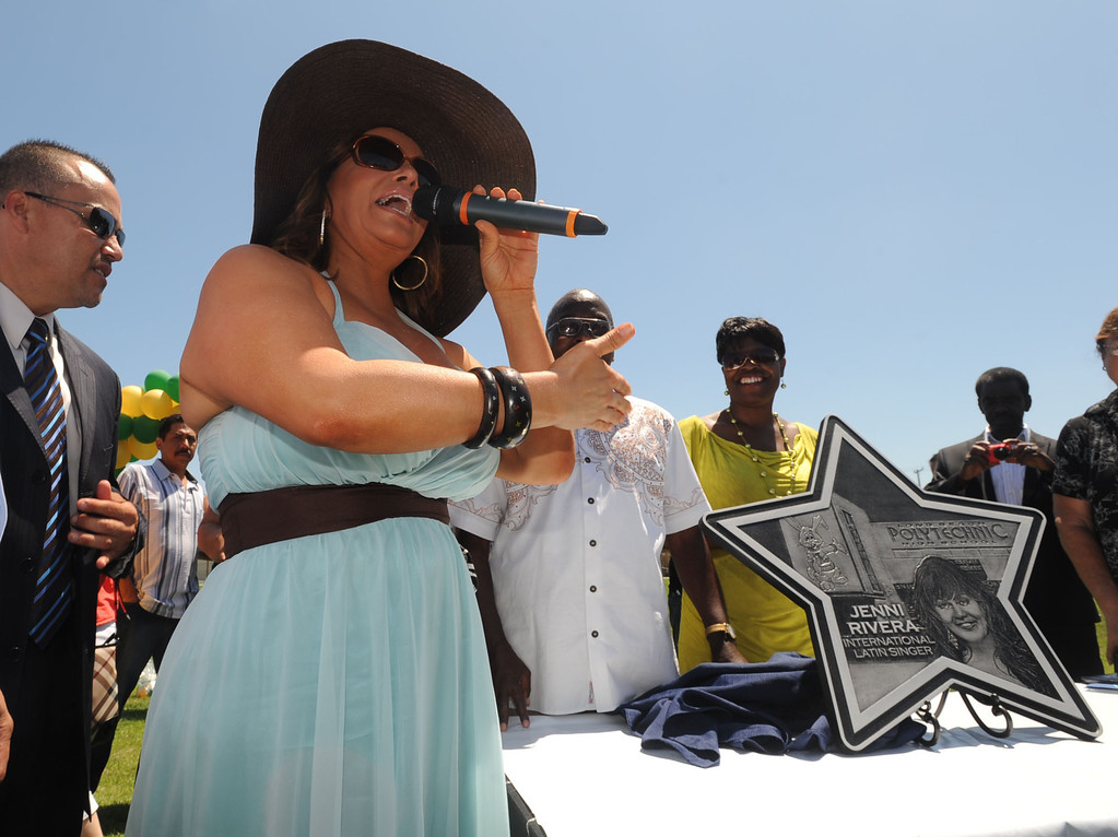 """. Long Beach Poly alum Jenni Rivera was honored Tuesday with a star on the Poly Walk of Fame. Rivera is internationally famous in the Latin music scene and also stars in her own reality television show.  The \""""star\"""" plaque is presented to Rivera..July 26, 2011..Photo by Steve McCrank / Daily Breeze"""