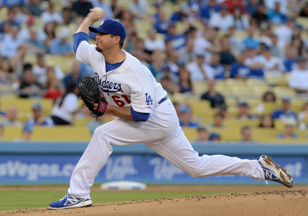 . Dodgers starting pitcher Josh Beckett delivers a pitch against the Nationals May 13, 2013 in Los Angeles, CA.(Andy Holzman/Staff Photographer)