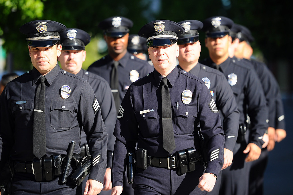 . Officers arrive for the funeral of LAPD Officer Roberto Sanchez at the Cathedral of Our Lady of the Angels in Los Angeles, CA May 14, 2014.  Sanchez was killed in a hit-and-run crash involving a SUV driver who is accused of deliberately ramming the officer\'s patrol car in Harbor City.(Andy Holzman/LA Daily News)