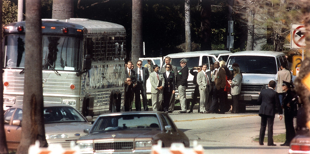 . Judge Lance Ito stands amid prosecution and defense attorneys as they wait for jurors to finish their visit to the crime scene at Nicole Brown Simpson\'s condominium on Bundy Drive in Brentwood. (2/12/95)   (Los Angeles Daily News file photo)