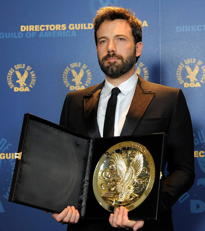 """. Ben Affleck poses backstage with his award for outstanding directorial achievement in feature film for \""""Argo\"""" at the 65th Annual Directors Guild of America Awards at the Ray Dolby Ballroom on Saturday, Feb. 2, 2013, in Los Angeles. (Photo by Chris Pizzello/Invision/AP)"""