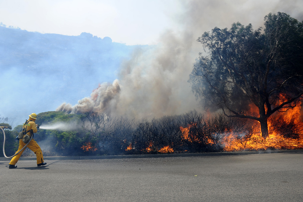 . Fire personnel attack flames approaching Cal State University Channel Islands Thursday, May 2, 2013. (Michael Owen Baker/Los Angeles Daily News)