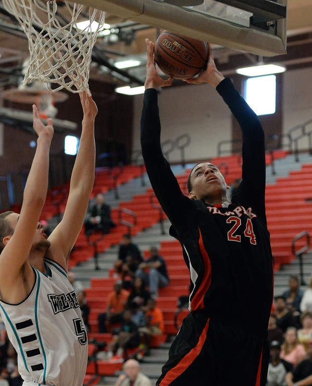 . View Park\'s Chance Comanche (C) (24) drives past Renaissance Academy \'s Kosta Jankovic (5) in the first half of a CIF Southern California Regional Division basketball game at Colony High School in Ontario, Calif., on Saturday, March 22, 2014.  (Keith Birmingham Pasadena Star-News)