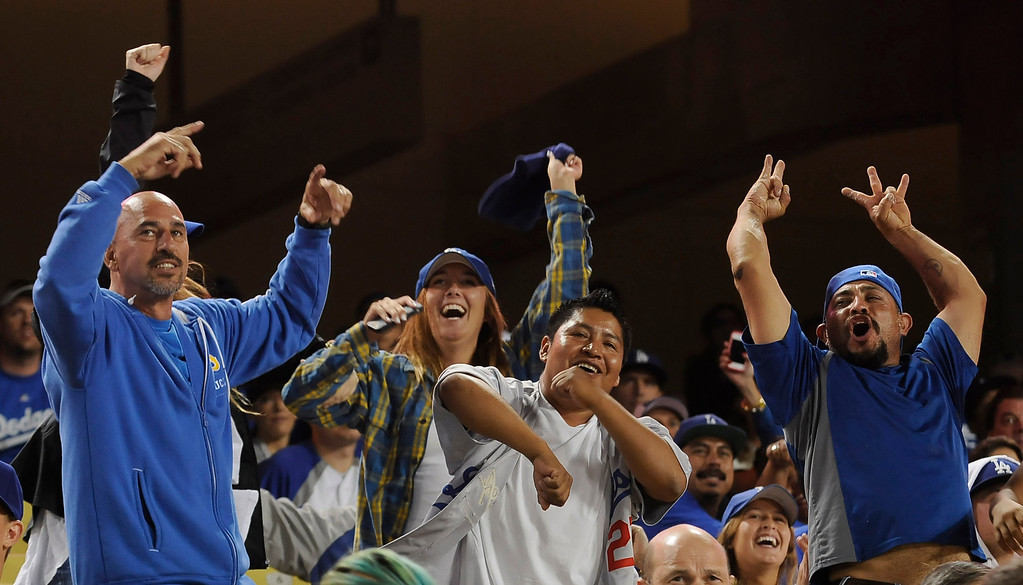 . Fans dance trying to get the attention of the Dodgers video photographer. Fans at Dodger Stadium have been treated to a lot of excitement. The Dodgers defeated the New York Mets 5-4 in 12 innings Wednesday night at Dodger Stadium in Los Angeles, CA. 8/13/2013(John McCoy/LA Daily News)
