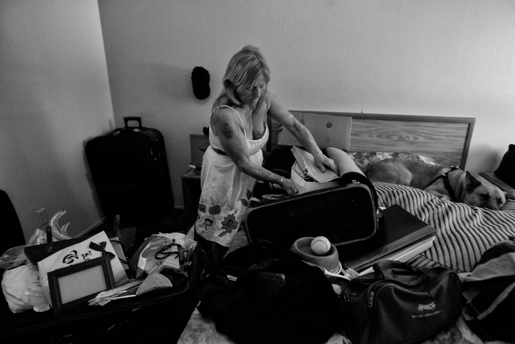 . Dorothy sorts through her clothes and belongings, as she settles into her motel room.