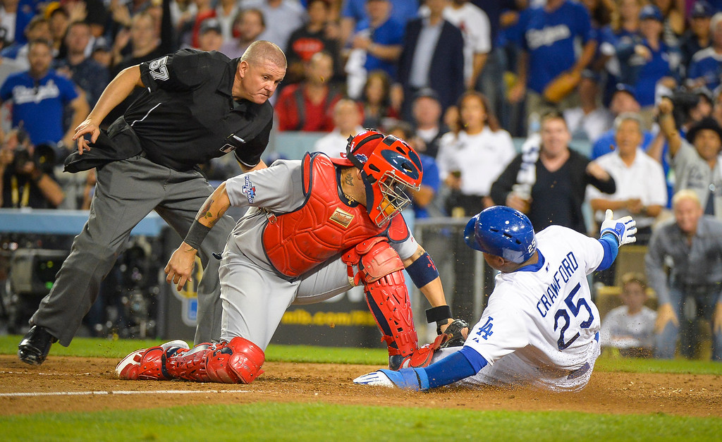 . Dodgers\' Carl Crawford scores as Cardinals\' Yadier Molina can\'t make the play in game 3 of the NLCS series at Dodger stadium Monday, October 14, 2013 ( Photo by Andy Holzman/Los Angeles Daily News )