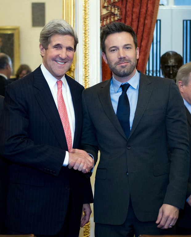. Sen. John Kerry D-Mass shake hands with actor Ben Affleck during a meeting with foreign relations members to discus the crisis in the Democratic Republic of Congo at Capitol Hill in Washington on Wednesday, Dec. 19, 2012. (AP Photo/Jose Luis Magana)