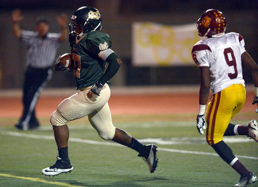 . Costa\'s running back Brandon Mills (27) scores a touchdown in first-half game action in the CIF Southern Section Northern Division first-round football game between the Highland High School Bulldogs and Mira Costal Mustangs at Costa Friday evening, 11/15/2013.  Photo for The Daily Breeze by Axel Koester, 11/15/2013.
