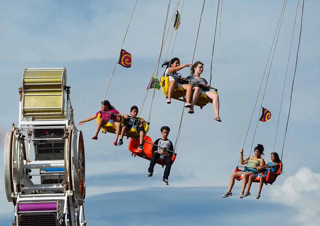 . Fair-goers enjoy Labor Day at the 91st annual Los Angeles County Fair in Pomona on Sept. 2, 2013. The fair will run through September 29. (Rachel Luna / San Bernardino Sun)