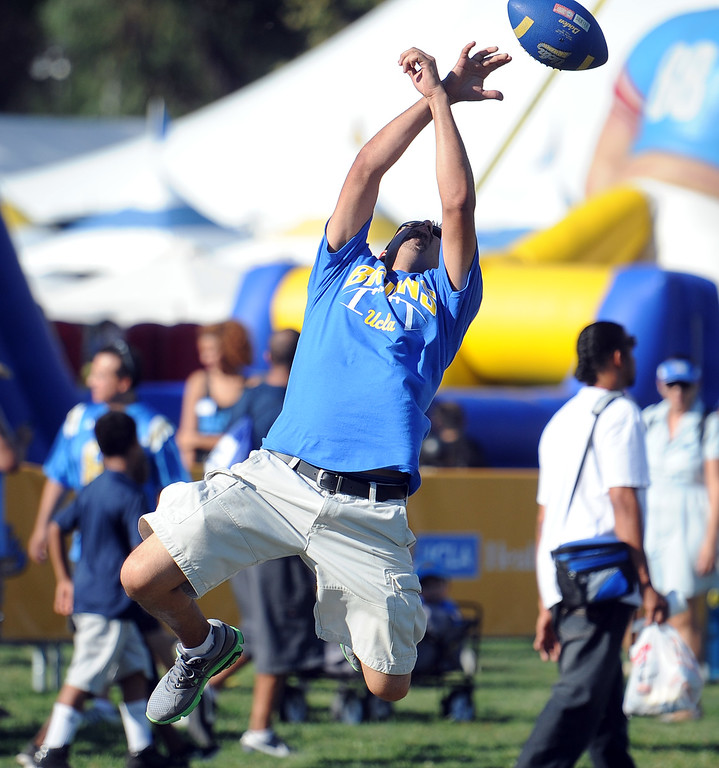 . Gabe Barrera plays catch prior to a college football game between Nevada and UCLA in the Rose Bowl on Saturday, Aug. 31, 2013 in Pasadena, Calif.    (Keith Birmingham Pasadena Star-News)