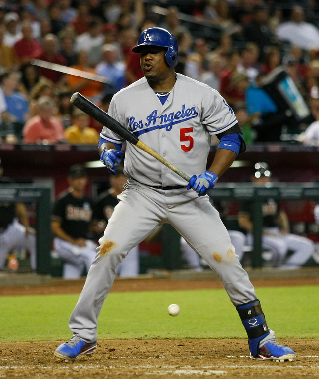 . Los Angeles Dodgers third baseman Juan Uribe (5) reacts on a strike in the third inning during a baseball game against the Arizona Diamondbacks on Monday, July 8, 2013, in Phoenix. (AP Photo/Rick Scuteri)
