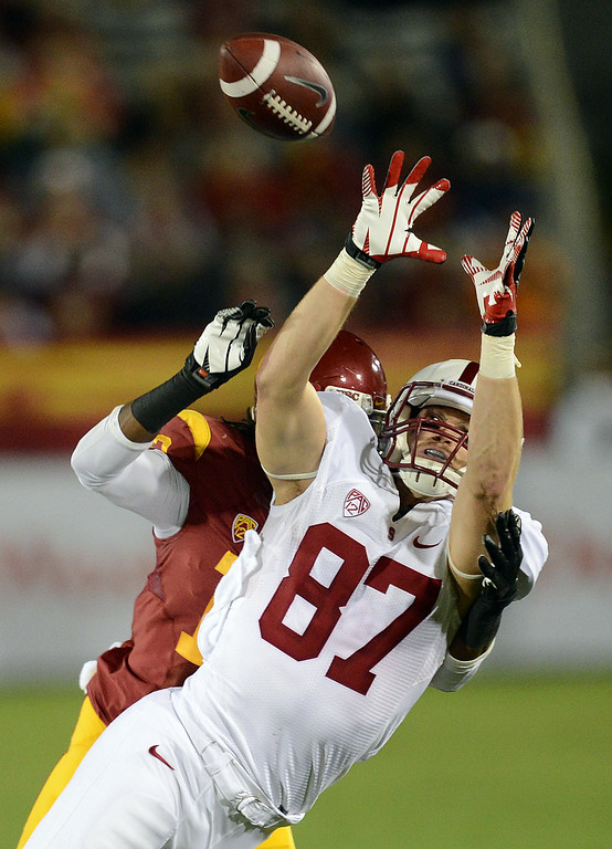 . USC�s Kevon Seymour #13 breaks up a pass intended for Jordan Pratt #87 during their game at the Los Angeles Memorial Coliseum Saturday, November 16, 2013. USC beat Stanford 20-17. (Photos by Hans Gutknecht/Los Angeles Daily News)