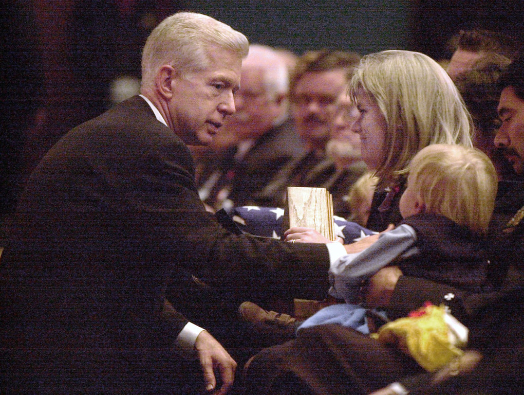 . California Gov. Gray Davis, left,  offers his condolences to Cathy Rucker inside the Marin Veterans Memorial Auditorium in San Rafael, Calif., Wednesday, Nov. 12, 2003, at the memorial service for her husband Novato California firefighter Steven Rucker, who was killed while fighting the Cedar Fire in San Diego County Oct. 29, 2003. (AP Photo, Robert Tong, Pool)