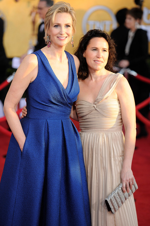 . Jane Lynch, left, and Lara Embry arrive at the 18th Annual Screen Actors Guild Awards on Sunday Jan. 29, 2012 in Los Angeles. (AP Photo/Chris Pizzello)