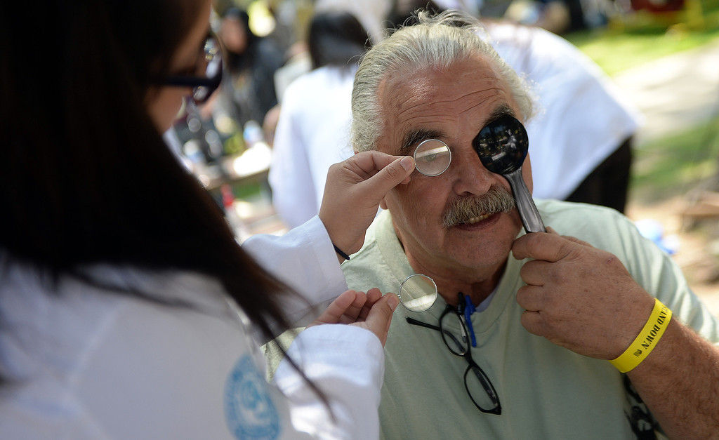 . Katie Allen, left, gives an eye exam to US Army veteran, during �Heroes in the Shadows� San Gabriel Valley Homeless Stand Down, A three day event presented by The Vet Hunters Project and The SGV Veterans Employment Committee aims to combat Homelessness by providing on site assistance, services and resources to those in need at Whittier Narrows Recreation Park in South El Monte, Calif., on Saturday, April 5, 2014.  (Keith Birmingham Pasadena Star-News)