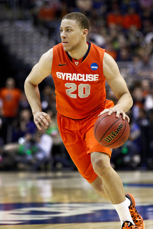. <b>Brandon Triche</b> <br />Guard, 6-4, 210. Averaged 13.6 points, 3.4 rebounds and 3.6 assists as a senior last year at Syracuse. Shot only 41.6 percent and 28.8 percent from 3-point range. Teams like his vision, energy and basketball IQ. (AP Photo/Mark Tenally)