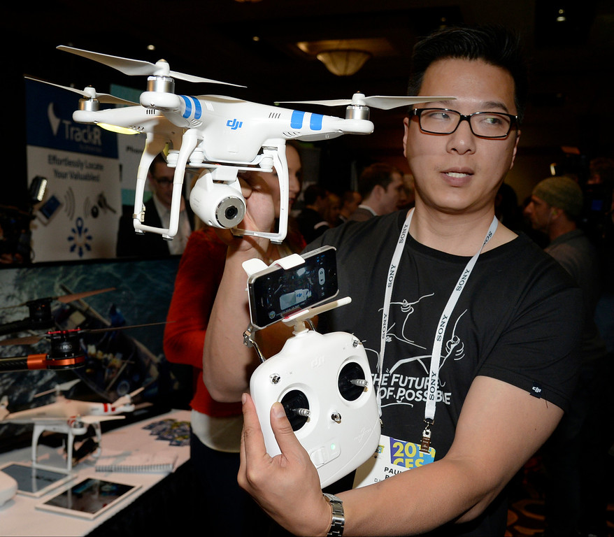 . Paul Pan of DJI Innovations shows the company\'s new Phantom 2 quadcopter that allows users to fly the copter with their smart phone during the 2014 Consumer Electronics Show (CES) on Sunday, June 5, 2014 in Las Vegas, Nevada. The 2014 CES show starts Tuesday, Jan. 7, 2014 and runs until Friday, Jan. 10, 2014 with 150,000 people estimated to attend the show. (Photo by Gene Blevins/Los Angeles Daily News)