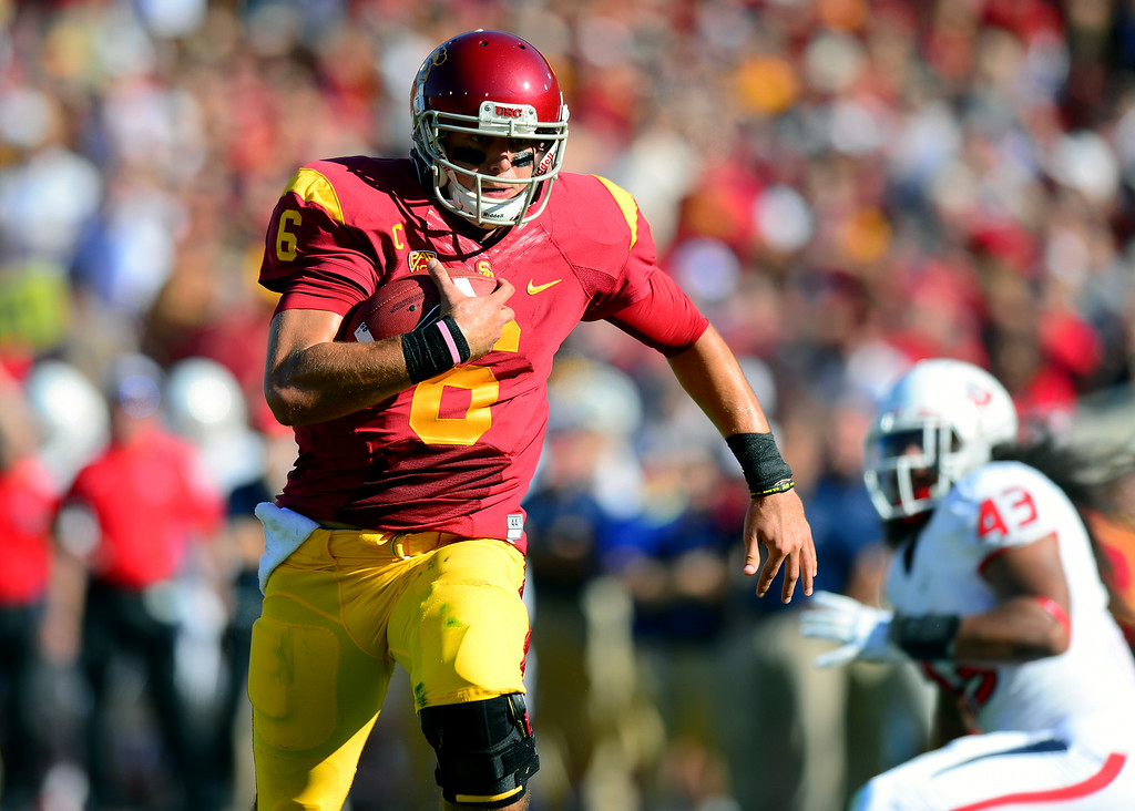 . USC QB Cody Kessler runs for a first-quarter touchdown against Fresno State, Saturday, August 30, 2014, at the L.A. Memorial Coliseum. (Photo by Michael Owen Baker/Los Angeles Daily News)