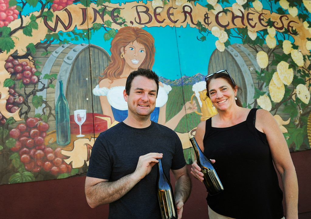 . Sean Fitzgerald, manager of Home Beer, Wine and Cheesemaking Shop, and worker Nancy Gold stand outside the  in Woodland Hills store, Thursday, April 24, 2014. (Photo by Michael Owen Baker/L.A. Daily News)