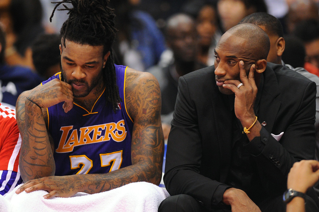 . Kobe Bryant and Jordan Hill sit on the bench as the Clippers beat the Lakers 123-87, Friday, January 10, 2014, at Staples Center. (Photo by Michael Owen Baker/L.A. Daily News)
