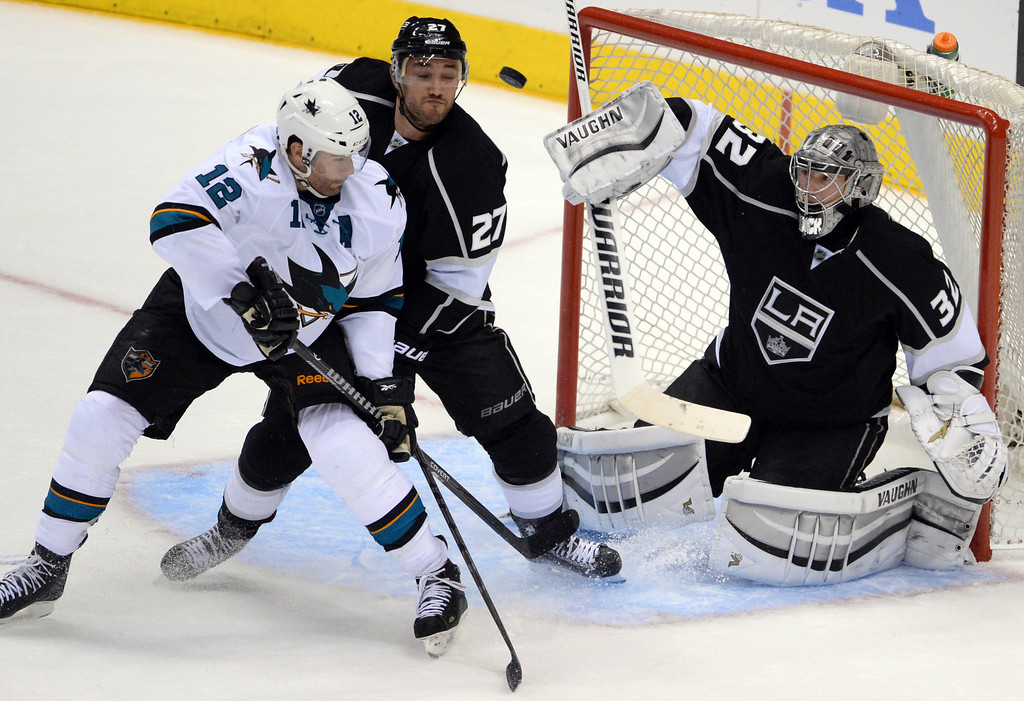 . Los Angeles Kings goalie Jonathan Quick (32) blocks a shot as Los Angeles Kings defenseman Alec Martinez (27) and San Jose Sharks center Patrick Marleau (12) fight for position during the third period in Game 4 of an NHL hockey first-round playoff series at Staples Center in Los Angeles on Thursday, April, 24  2014. Los Angeles Kings won 6-3. (Keith Birmingham Pasadena Star-News)
