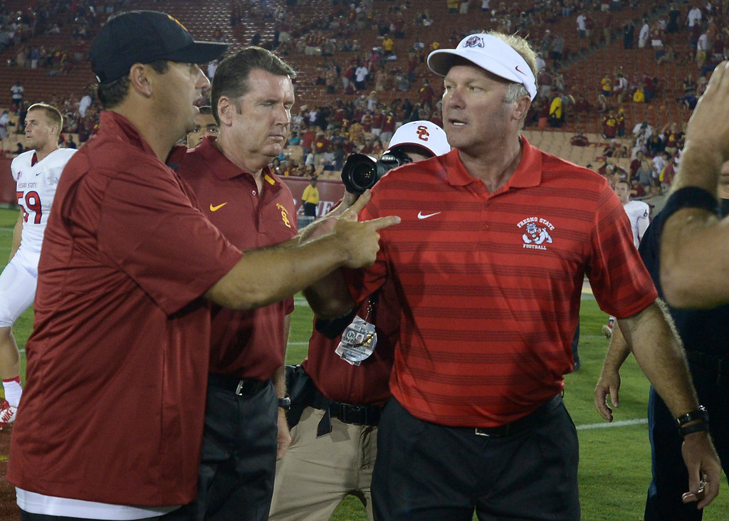. Steve Sarkisian shakes hands with Fresno Coach Tim DeRuyter after the game. USC defeated Fresno State 52-13 at the Los Angeles Memorial Coliseum. Los Angeles, CA. 8/30/2014(Photo by John McCoy Daily News
