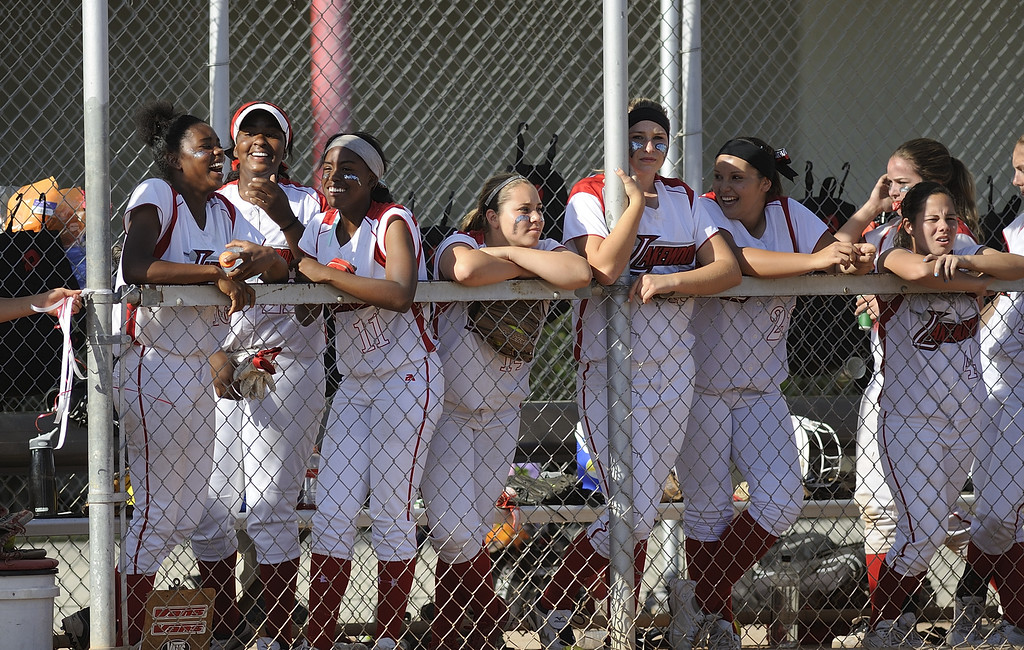 . LONG BEACH, CALIF. USA -- Lakewood is all smiles during their 11 to 1 victory over Wilson in Lakewood, Calif., on May 2, 2013.  Photo by Jeff Gritchen / Los Angeles Newspaper Group