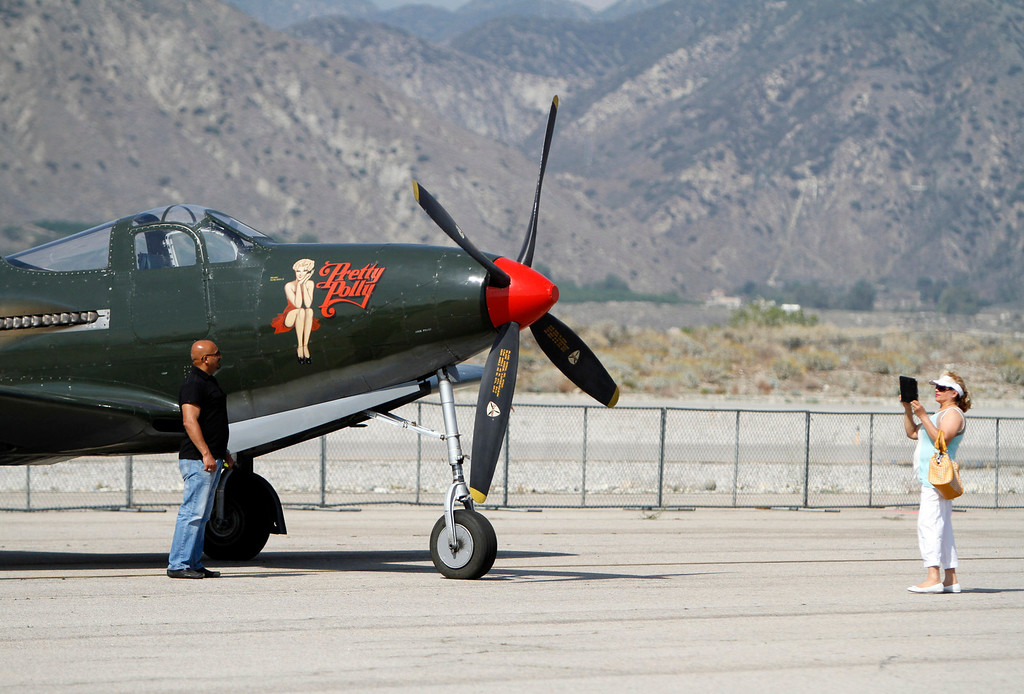 . Nadia Zahir, right, take a photo of Wali Zahir , of Redlands, during the Hangar 24 AirFest and 6th Anniversary Celebration on Friday, May 16, 2014 at the Redlands Municipal Airport in Redlands, Ca. (Photo by Micah Escamilla/Redlands Daily Facts)