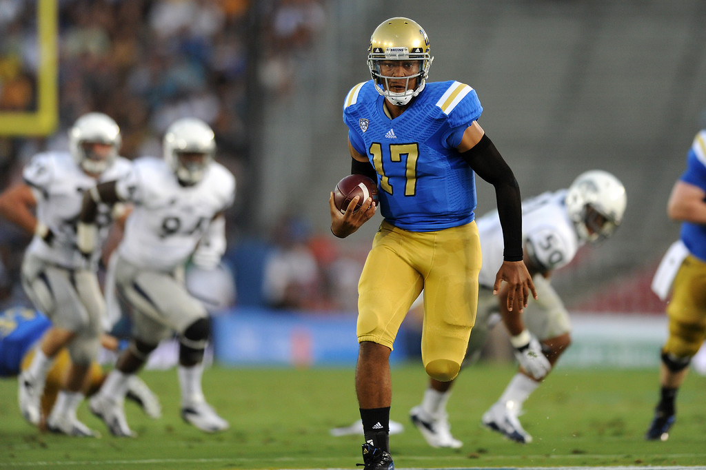 . UCLA QB Brett Hundley runs for a 37-yard touchdown in the first quarter against Nevada, Saturday, August 31, 2013, at the Rose Bowl. (Michael Owen Baker/L.A. Daily News)
