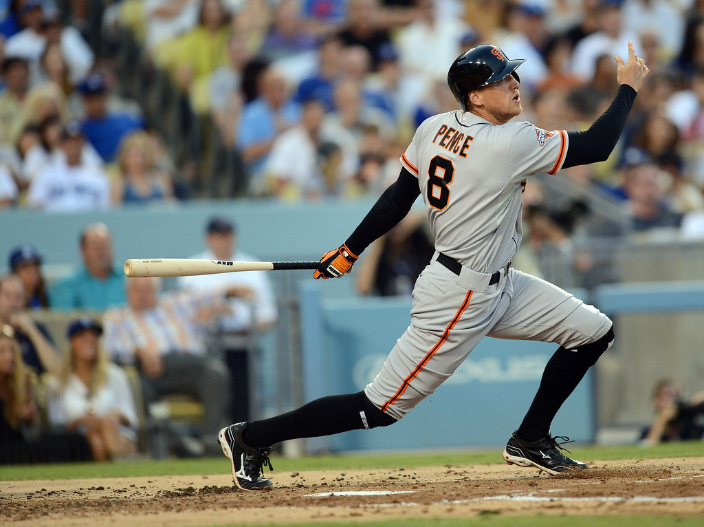 . The Giants\'  Hunter Pence #8 hits a 2-RBI single during their game against the Dodgers at Dodgers Stadium Saturday, September 14, 2013. (Photo by Hans Gutknecht/Los Angeles Daily News)