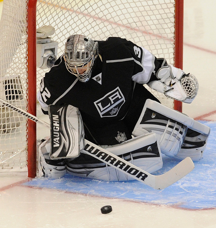 . Kings#32 Jonathan Quick stops a puck in the 2nd period. The Kings played the San Jose Sharks during the first game in the Second Round of the Western Conference Playoffs. Los Angeles CA 5/14/2013(John McCoy/LA Daily News)