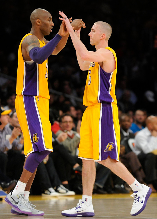. Lakers#24 Kobe Bryant comes off the bench to replace, and congratulate Lakers#5 Steve Blake in the 4th quarter. The Lakers defeated the New Orleans Hornets 111-106 in a game at Staples Center in Los Angeles, CA 1/29/2013 (John McCoy/Los Angeles Daily News)