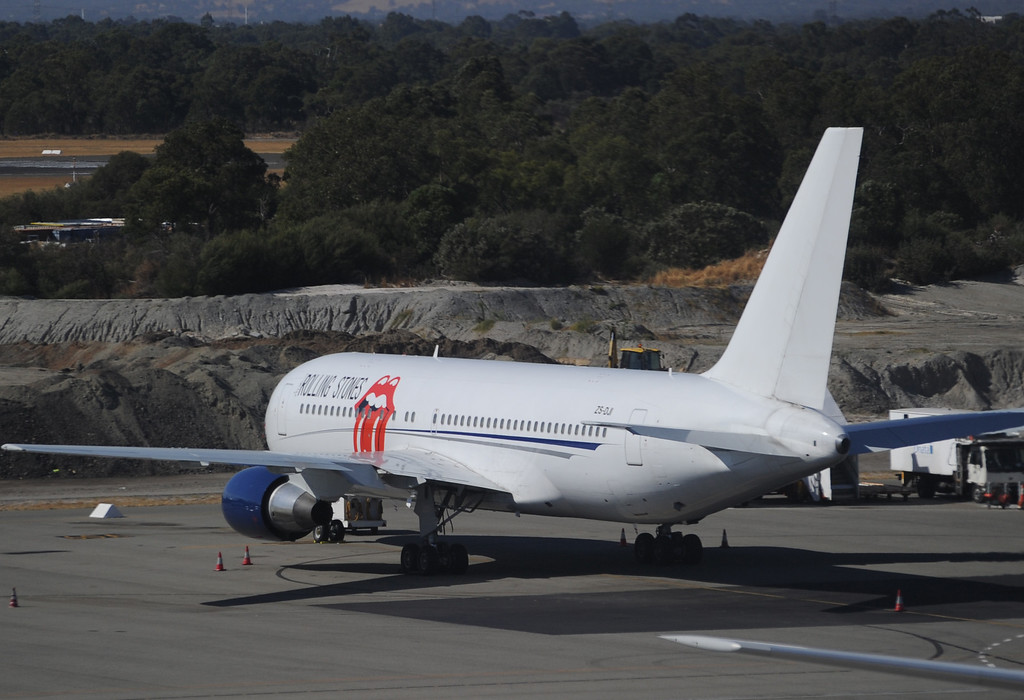 . The private jet of British band \'Rolling Stones\' is parked on the tarmac at Perth International Airport on March 18, 2014. The Rolling Stones on March 18 cancelled the first gig of their Australian tour after the death of frontman Mick Jagger\'s girlfriend L\'Wren Scott.     (GREG WOOD/AFP/Getty Images)