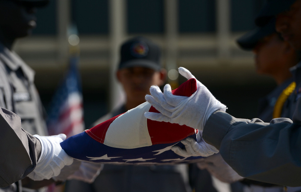 . Cadets from Sunburst Youth Academy perform a flag folding ceremony Wednesday May 22, 2013 at CalState San Bernardino. In recognition of Memorial Day, Cal State�s Student Veterans Organization and the Veterans Success Center pays tribute to fallen military service members, and former CalState student Alejo Thompson. Thompson was a U.S. Army 1st Lt. killed  last year in Parwan Province. Based at Fort Carson, Colo., he was assigned to the A Company, 1st Battalion, 12th Infantry Regiment, 4th Infantry Division. (Rick Sforza/Staff photographer, The Sun)