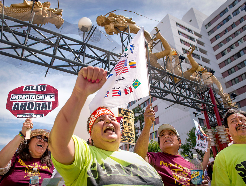 . Ana Castro of Los Angeles chants along with speakers during speeches under the Chinatown Dragons Gate.  The Coalition for Humane Immigrant Rights of Los Angeles (CHIRLA) joined area organizations and coalitions to march in honor of worker contributions and denounce deportations of undocumented immigrants living in the United States May 1, 2014.   (Staff photo by Leo Jarzomb/San Gabriel Valley Tribune)